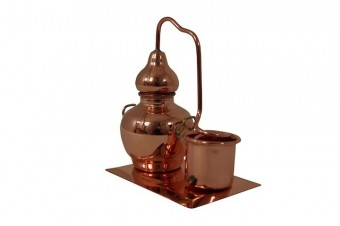 """CopperGarden®"" Miniature Alembic with condenser on a copper plate"